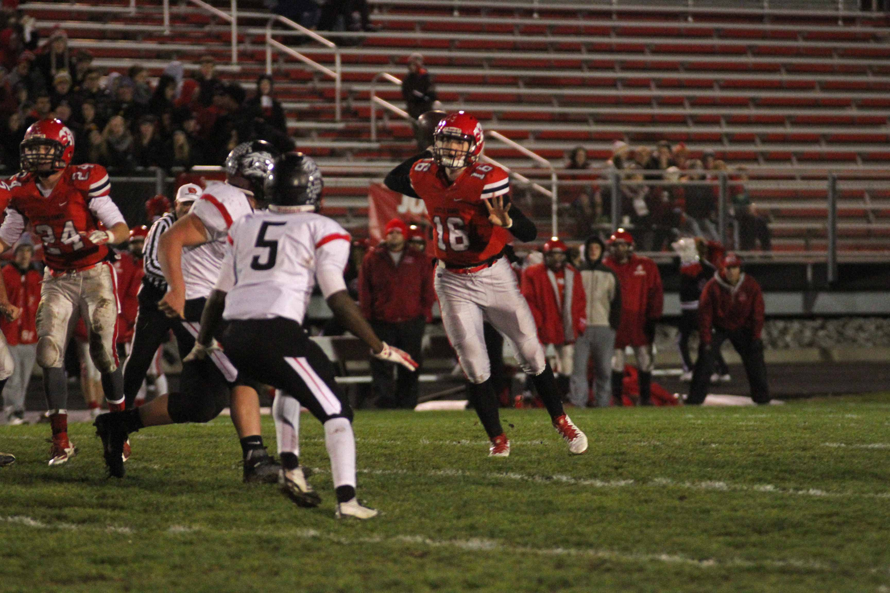 Jared Taylor '17 throws a pass in the first half at Bates Field in the first round playoff game against Linn-Mar.