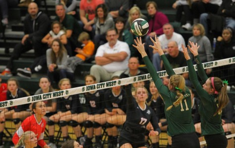 West's Emily Halverson '17 sets the ball back over the net.