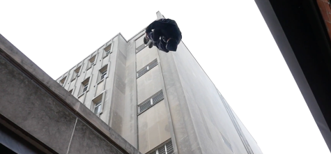 Ronnie McDowell performing a gap jump in downtown Iowa City. WARNING: stunts performed by a trained professional.