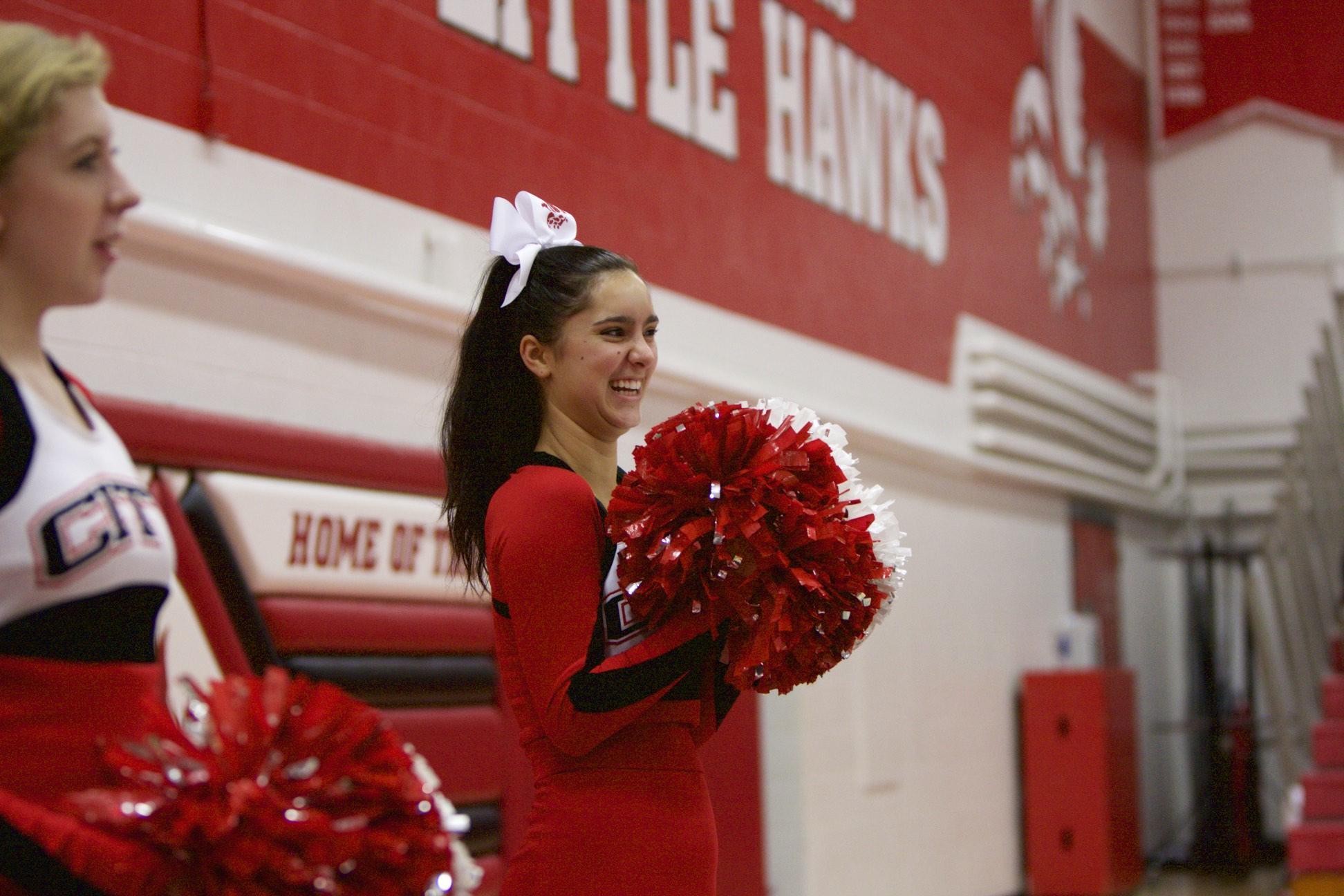 Lauren O'Brien '16 cheers on the team.