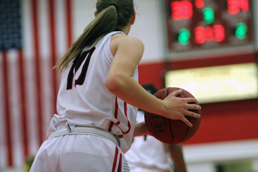 Ashley Joens 18 looks down court to pass.