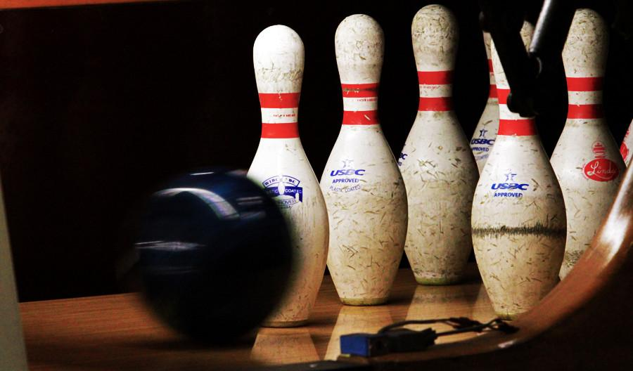A+ball+rolls+towards+the+pins+during+bowling+practice+at+Colonial+Lanes