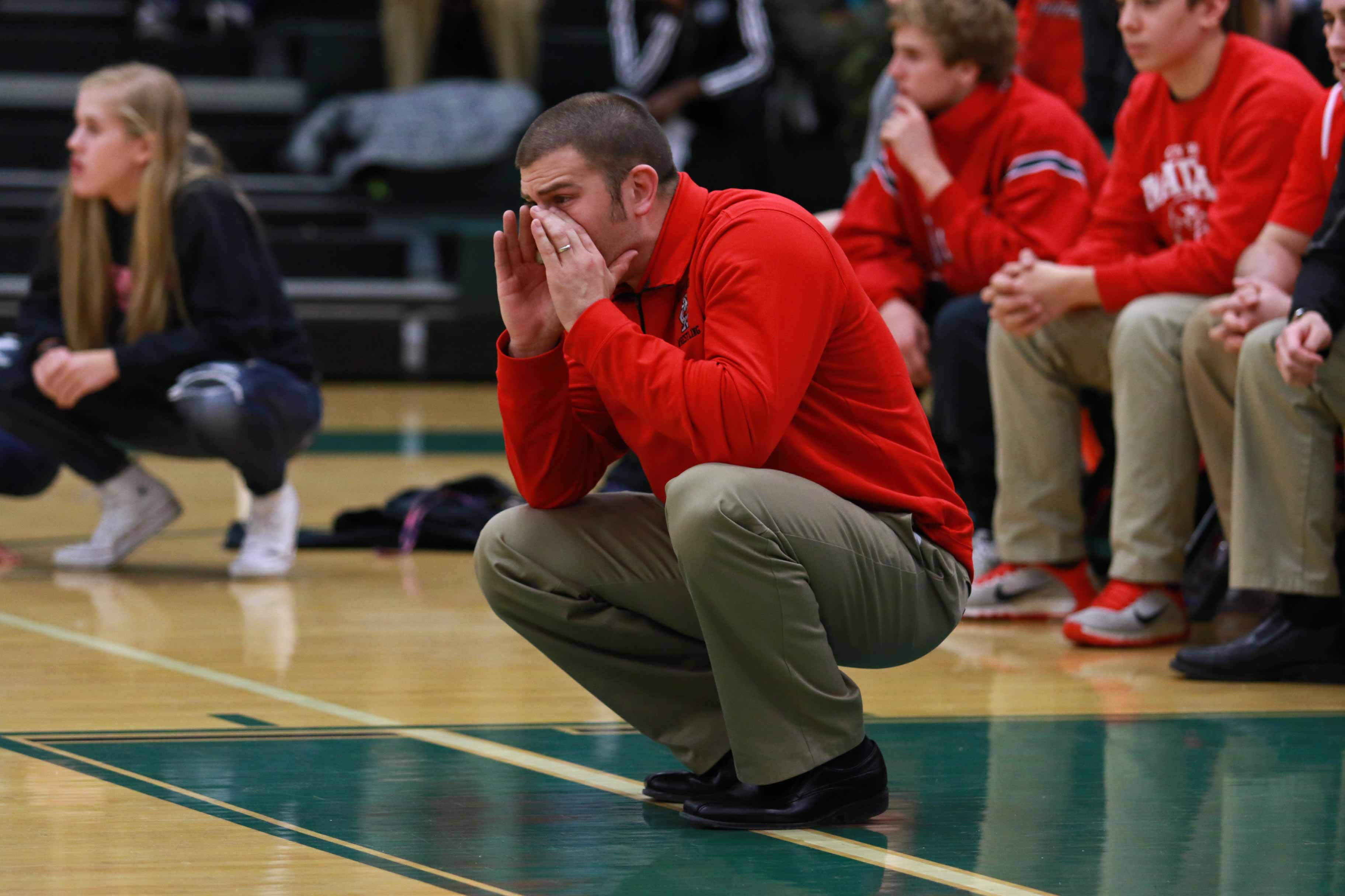 City+High+wrestling+coach+Cory+Connell+yells+instructions+during+a+heated+bout+against+West+High%27s+Trojans++on+January+7th%2C+2016.