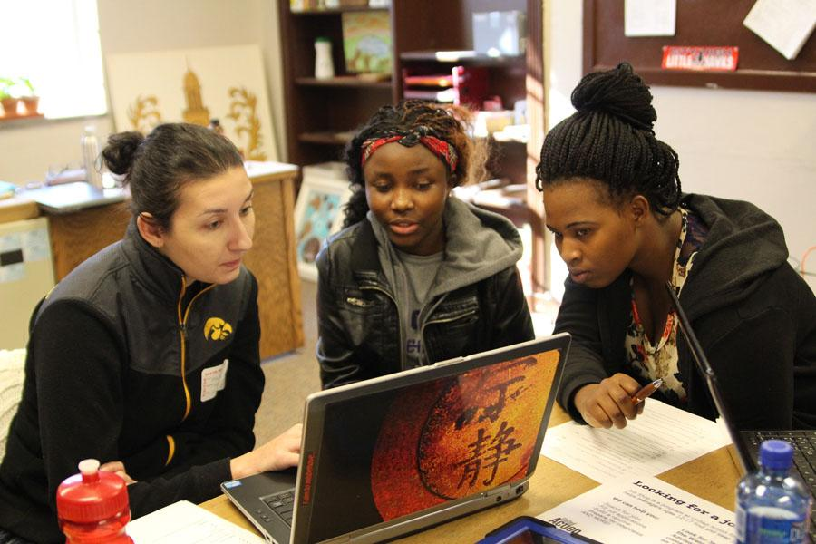 UAY staff member assists two City High students to find jobs.