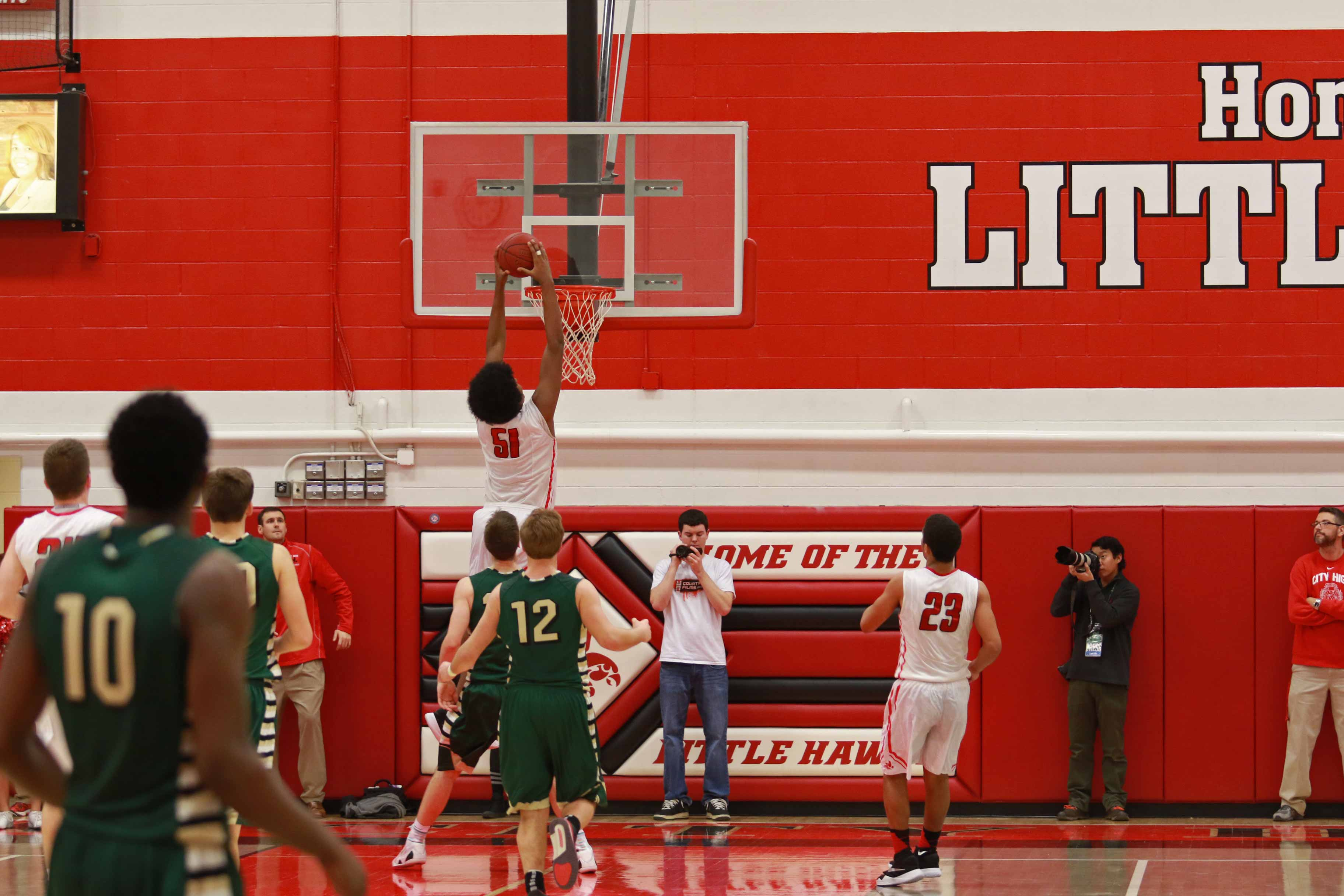 Micah+Martin+%2716+soars+towards+the+rim+while+dunking+against+West+High%27s+Trojans+on+Friday%2C+February+12th%2C+2016+at+City+High.