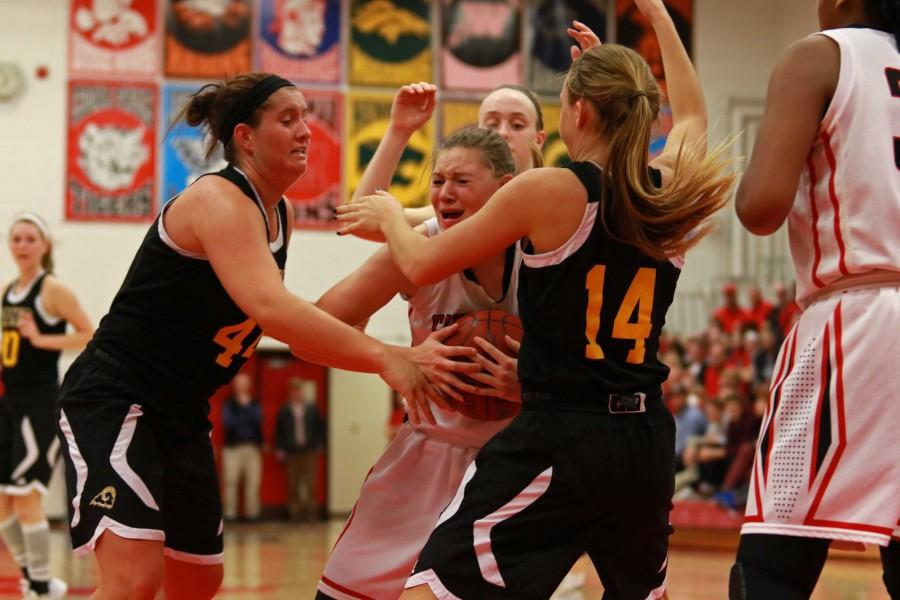 Ashley Joens '18 fights to keep possession while being covered by three Southeast Polk defenders at City High.