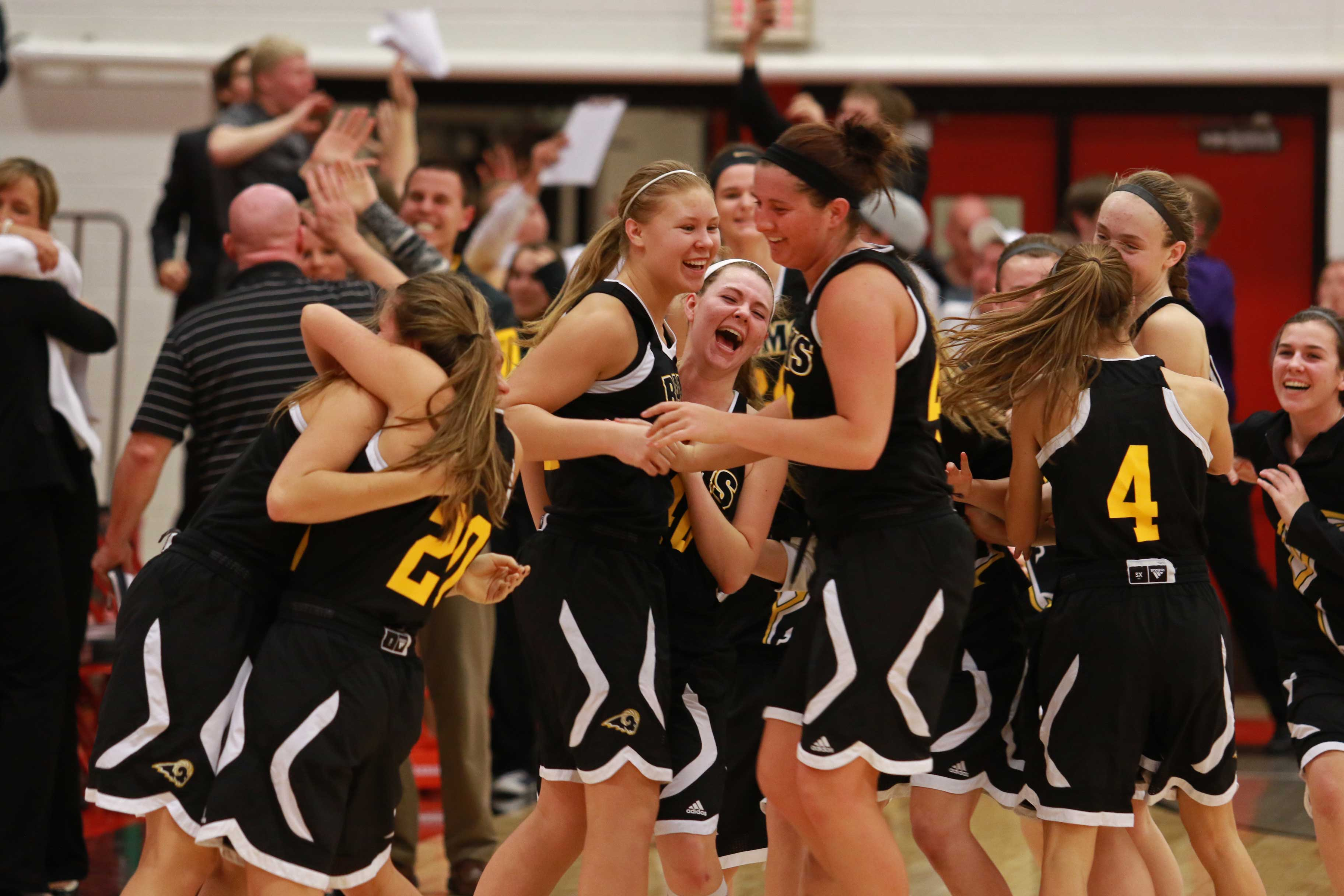Southeast+Polk+girls+celebrate+after+their+win+over+City+High+advancing+them+to+the+state+tournament.