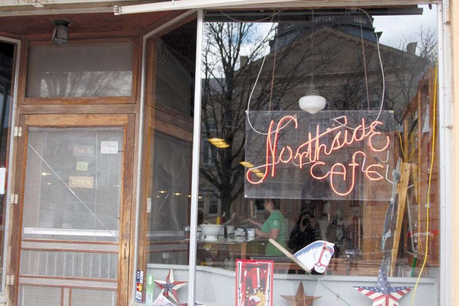 A+neon+sign+hangs+in+the+window+of+the+Northside+Cafe%2C+which+is+located+on+the+main+square+of+Winterset%2C+Iowa.