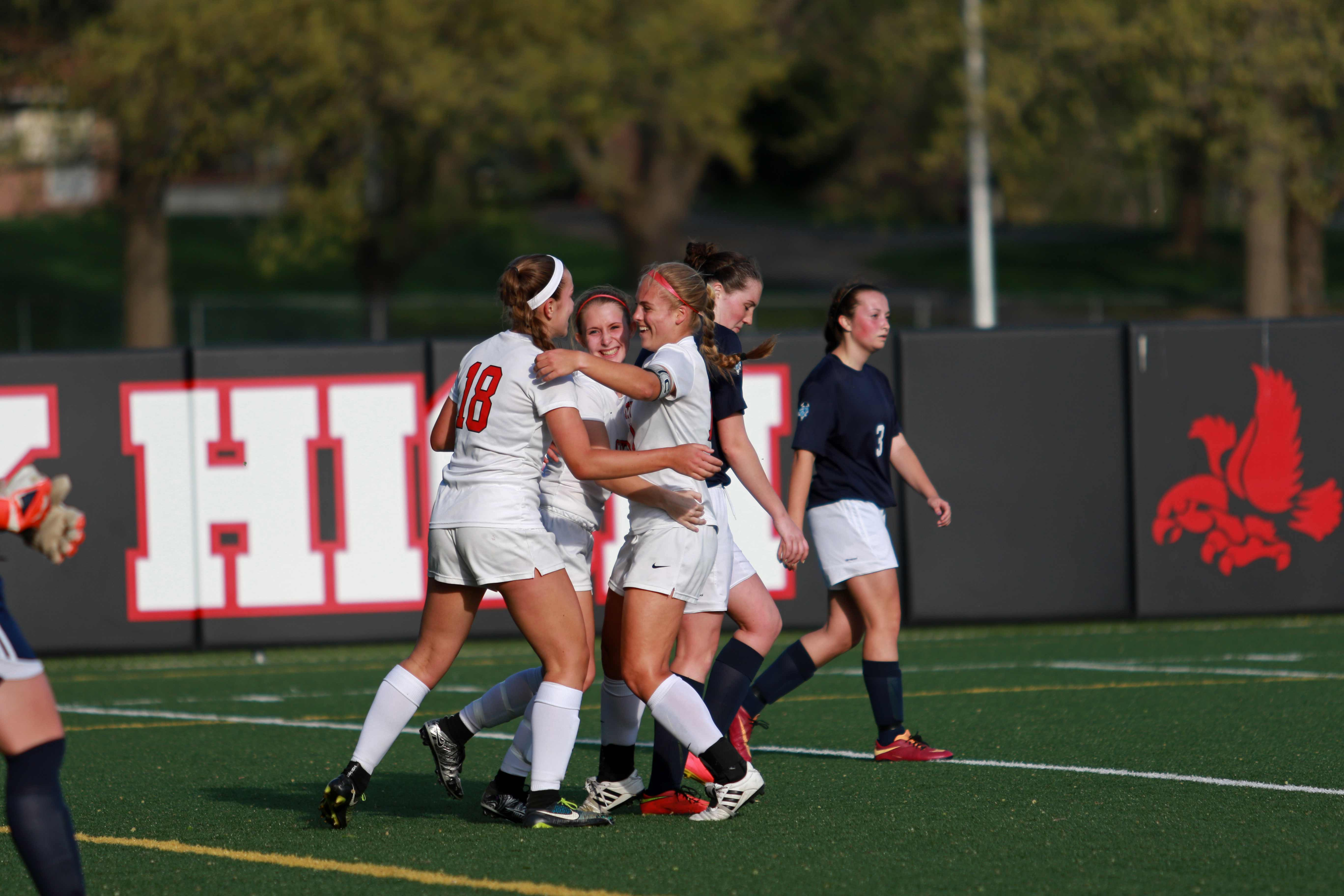 Teammates celebrate with Grace Brown '17 after her goal in the 39th minute in the first half on April 26th, 2016.