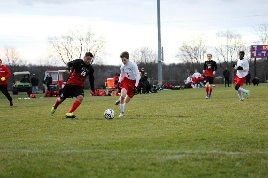Dennis Espinal '18 works his way around a defender.