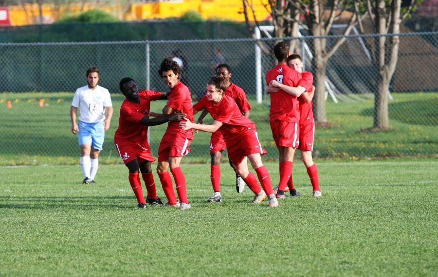 Nasim Salih '16 celebrates with teammates after scoring a goal.