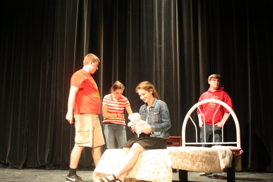 Strathearn rehearses Hopelessly Devoted To You during set change.