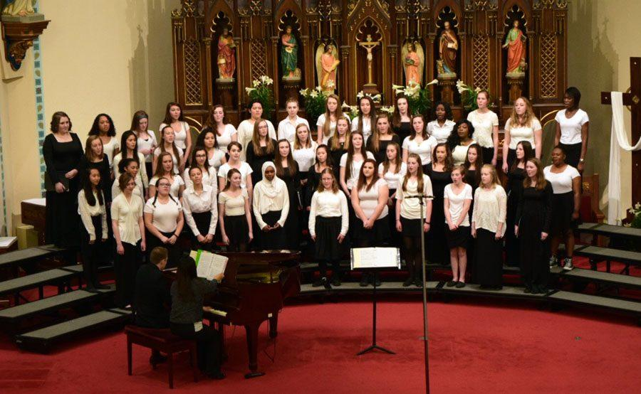 The City High Singers, under the direction of James Berry, perform their first piece.