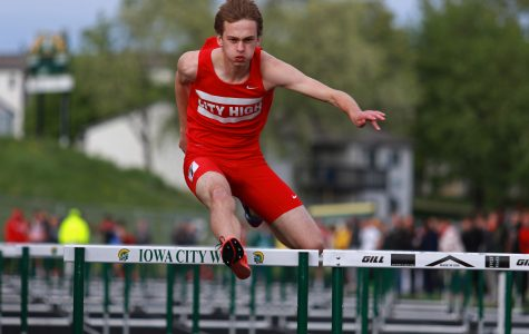 Sy Butler '16 clears a hurdle on Thursday, May 12th, 2016 at West High in the shuttle hurdle relay.