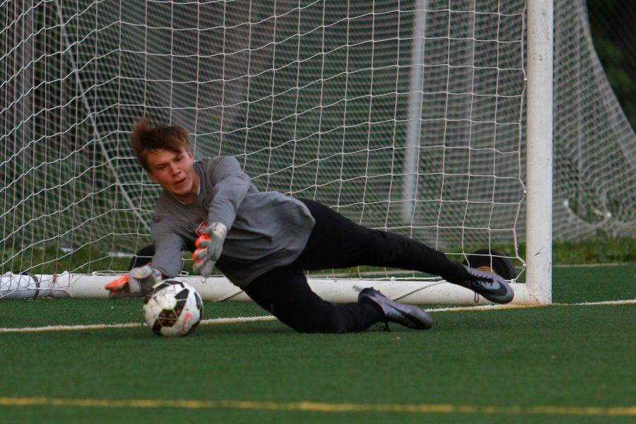 City High's keeper Sam Tomek '17 saves West High's final shot of the shootout to advance them to their next round on Tuesday, May 17th, 2016.