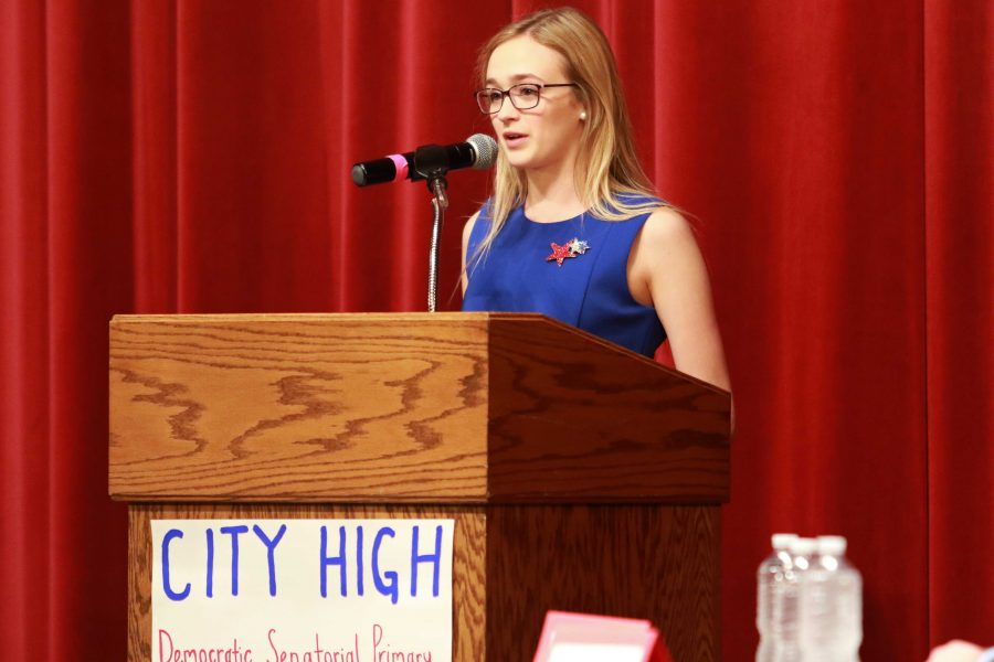 Laura Cornell '16 speaks during the beginning of the debate, while introducing candidates and stating the rules for the night on May 27th, 2016 in City High's Opstad Auditorium.