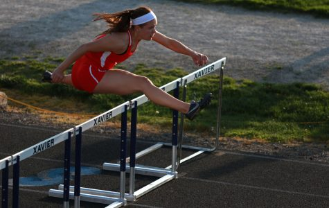 Elke Windschitl '16 clears an obstacle in the 110 meter hurdles at the Mississippi Valley Conference divisional meet.
