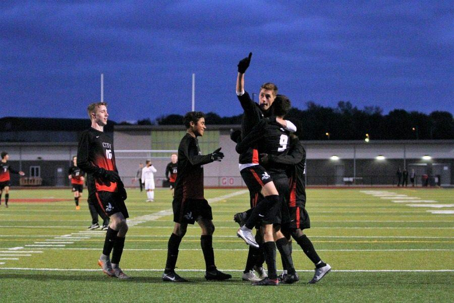 Mitch McCarthy holds up the number one after a 4-0 win against Linn Mar