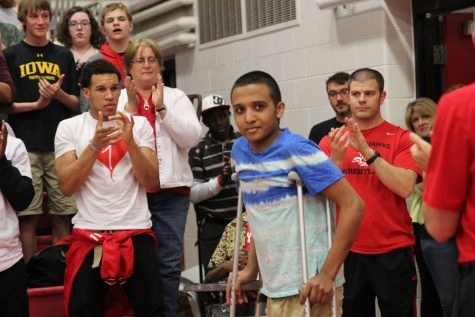 Martin Luna '17 walks into the spring pep assembly as everyone cheered for him.