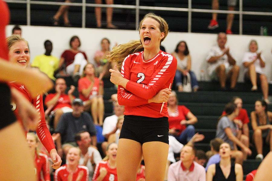 Sydney Schroeder '17 is filled with emotion after a crucial point against the Trojans.