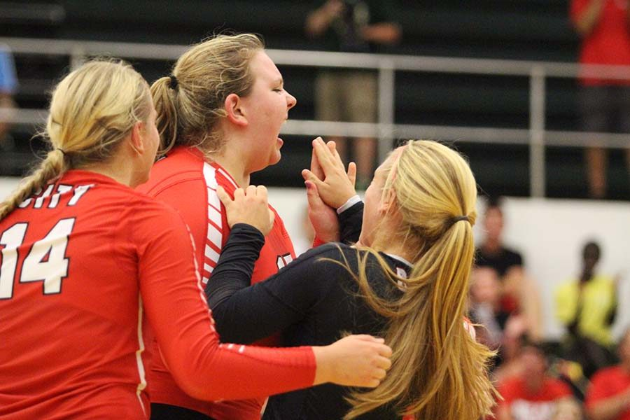City celebrates after winning set two against rival West High