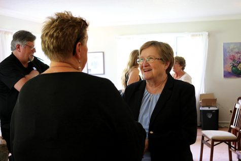 Patty Judge speaks with a supporter at an event in Iowa City on September 24th.
