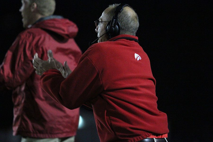 Coach Dan Sabers and son Mike Sabers jumping up and down after a play.