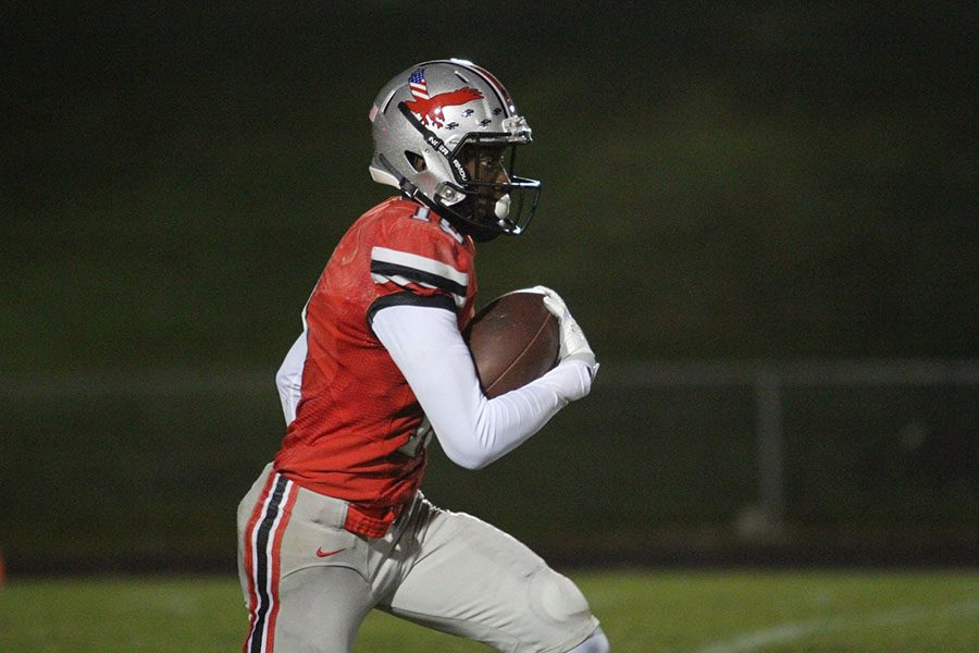 Vance Dillon '17 runs the ball for a 99 yard return touchdown.