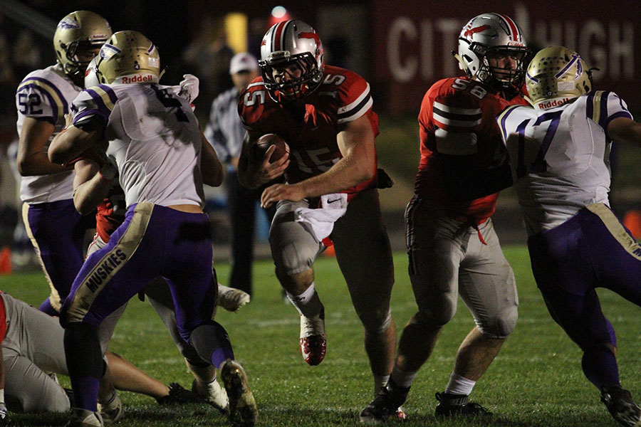 Quarterback Nate Wieland '17 rushes in for a touchdown against Muscatine.