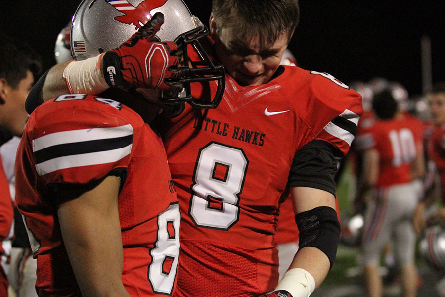 QB+Nate+Weiland+celebrates+after+beating+Muscatine+in+the+homecoming+game.