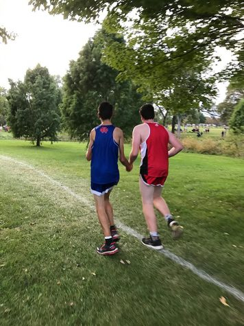 Evan Hanson '19 assists a Washington runner during a race at Noelridge Park.