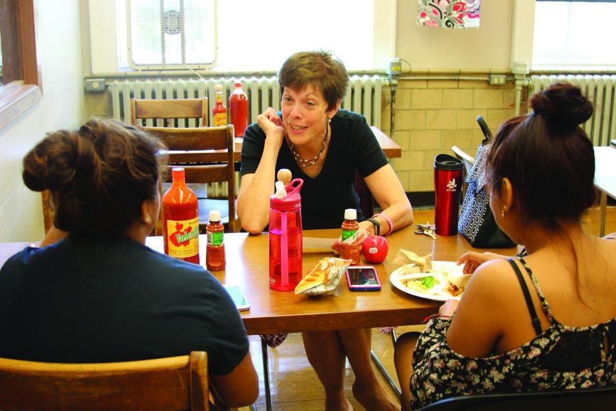 Beatriz Gemartino '17 and Estefanie Gracia-Rojas '17 converse with Biology teacher Tina Koepnick