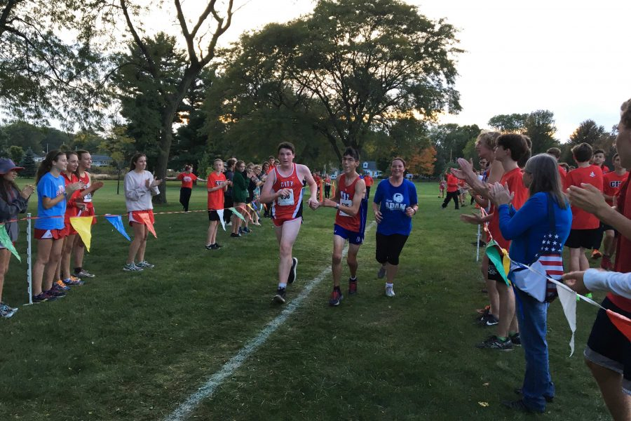 Evan Hansen '19 and Adam Todd '18 finish together during the JV Boys Cross Country race at Noelridge Park on Thursday, October 6th.