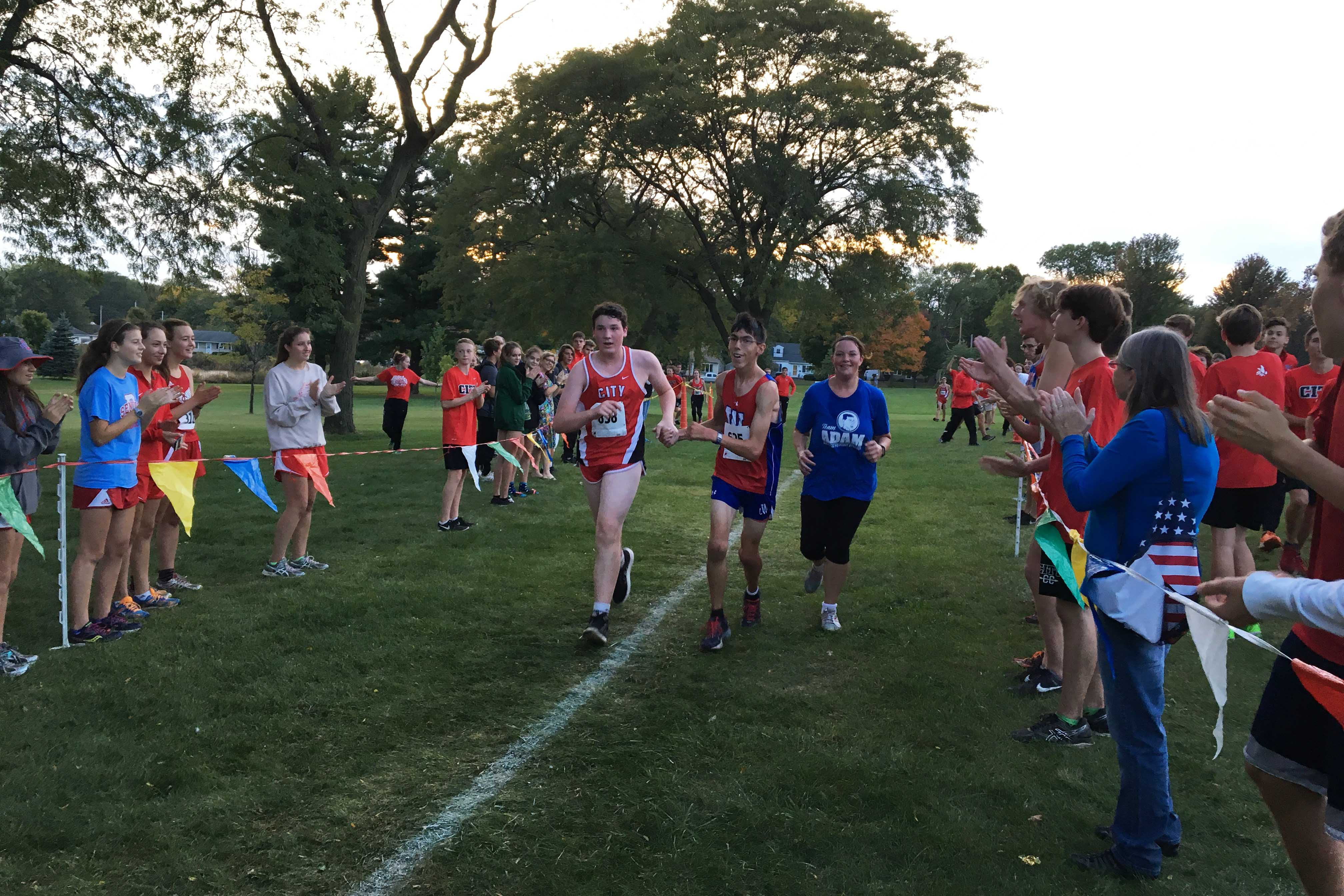 Evan+Hansen+%2719+and+Adam+Todd+%2718+finish+together+during+the+JV+Boys+Cross+Country+race+at+Noelridge+Park+on+Thursday%2C+October+6th.+