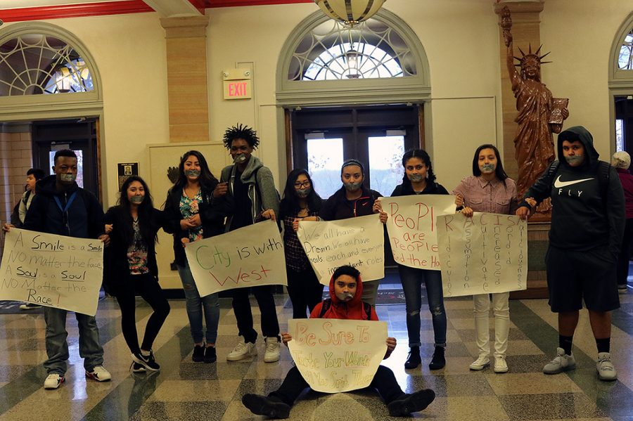 A group of ten students silently protested discrimination and acts of hate at City High on Friday, November 18th.  Earlier this week, a group of West High students organized a sit-in expressing the same sentiment.