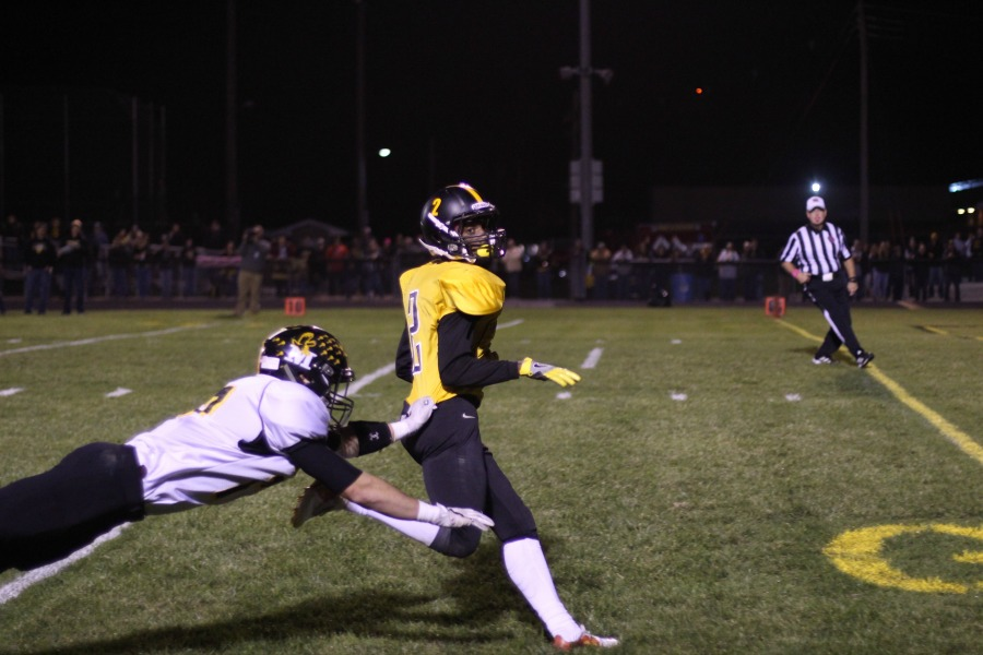 Lone Tree's Jovonte Squiers (#2) escapes the grasp of a Midland defender during his 54 yard punt return touchdown in the second quarter. It was his fourth punt return touchdown of the season.