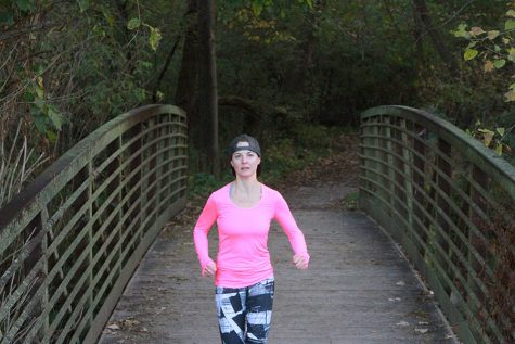 Assistant Principal Natalee Thompson runs in Hickory Hill Park