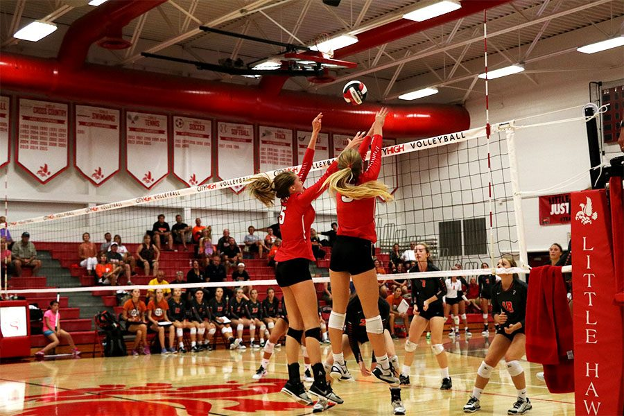 Mackenzie Murphy '19 and Alexa Ingram '17 attempt to block a spike.