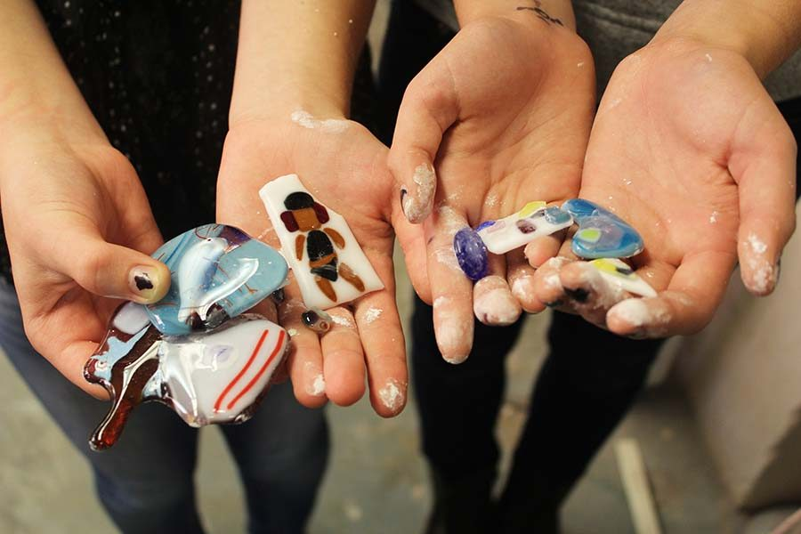 Nina Lavezzo-Stecopoulos and Maria Buri show glass pieces they made at Art Club