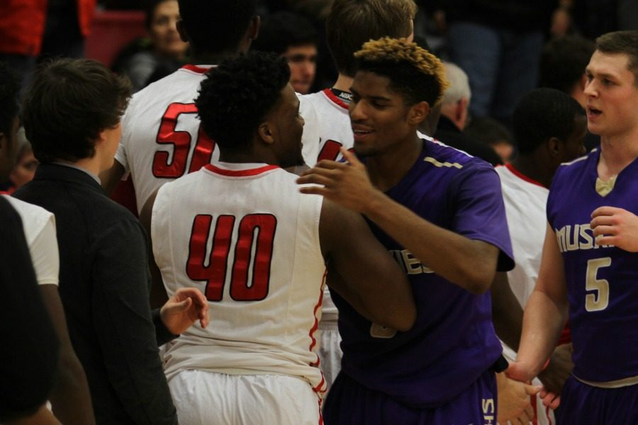 Chuck Johnson '17 talks to a Muscatine player following City's 46-70 loss to the Muskies