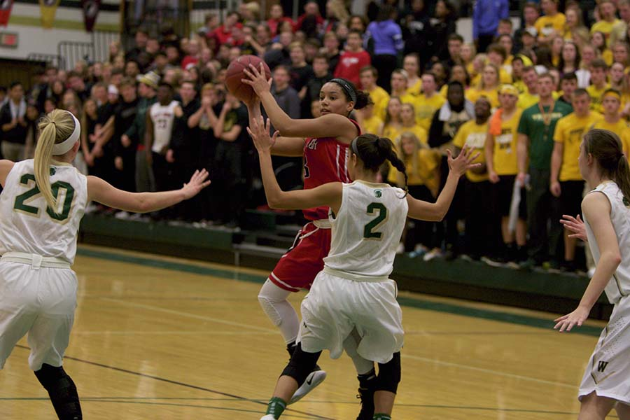Rose Nkumu '20 searches for a teammate to pass to against West High on December 13th at West.