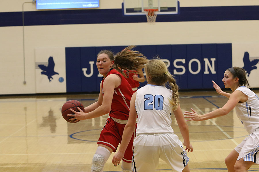 Ashley+Joens+%2718+tries+to+get+past+a+defender+as+she+drives+to+the+basket+against+Jefferson.+