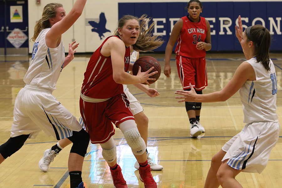 Ashley Joens' 18 goes to the lane while closely being guarded by Jefferson defenders.