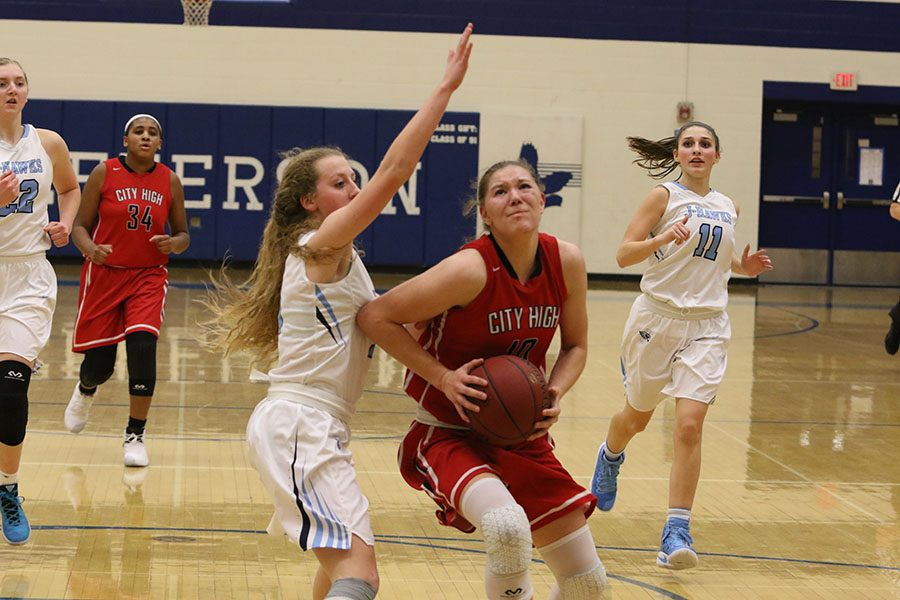 Ashley Joens '18 drives to the basket against Jefferson.