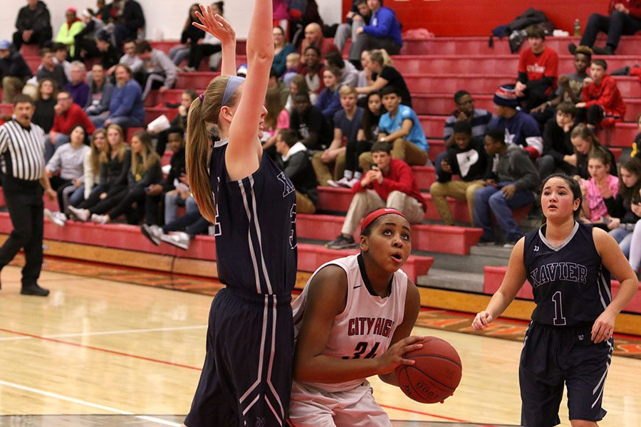 Kenya Earl '17 looks to shoot as she is defended by a Xavier player during City's game against Xavier on January 13.
