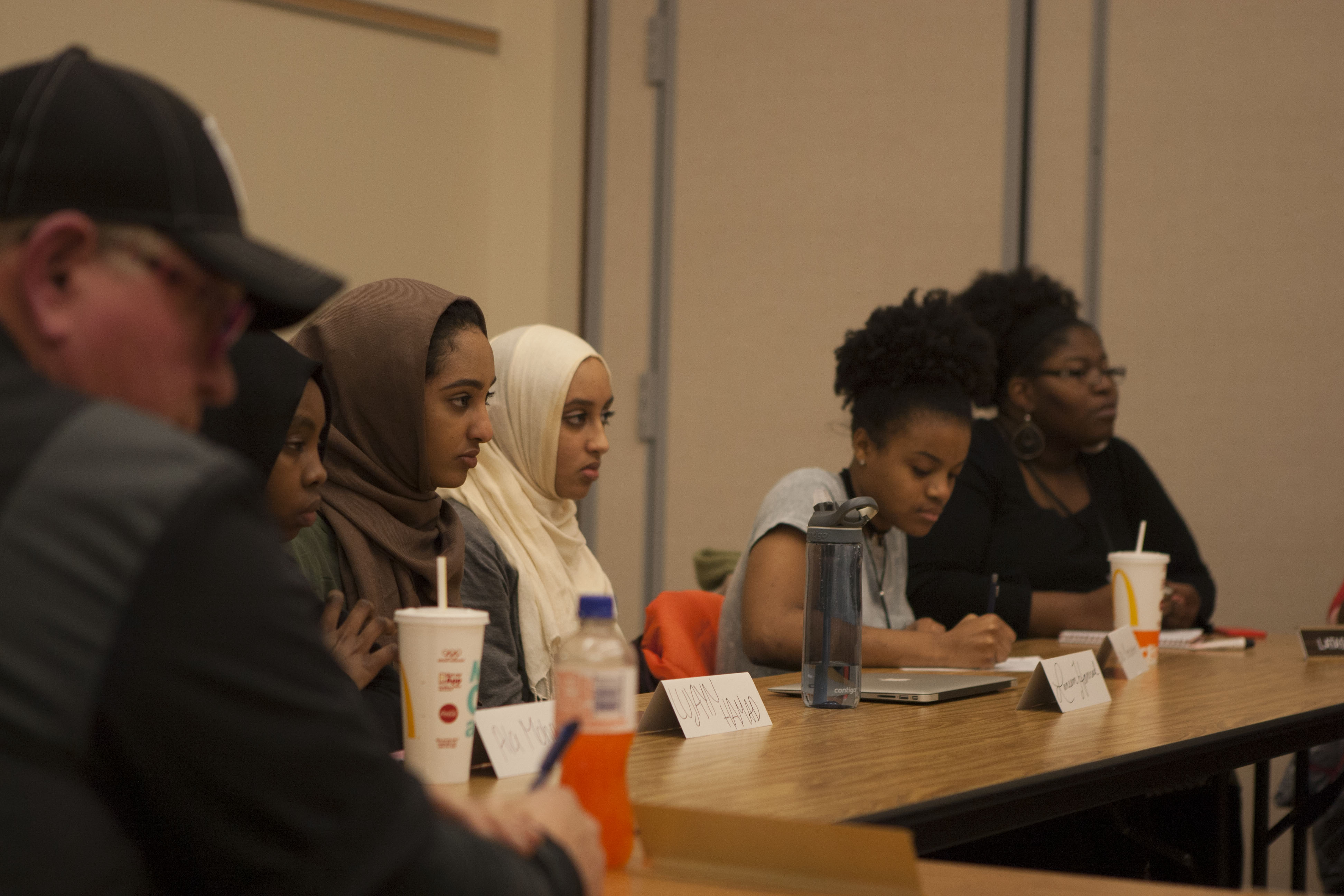 West High students listen to a member of the school board.