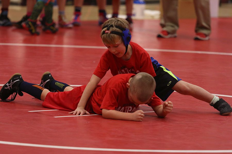Iowa City youth wrestling shows their skills off during an intermission.