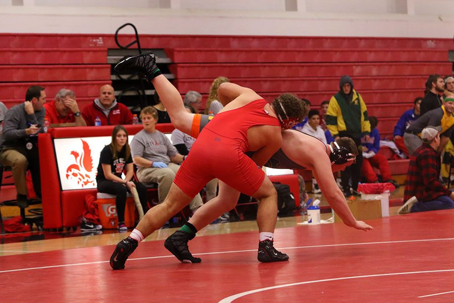 Jordain Buckland '17 throws his opponent into the ground.