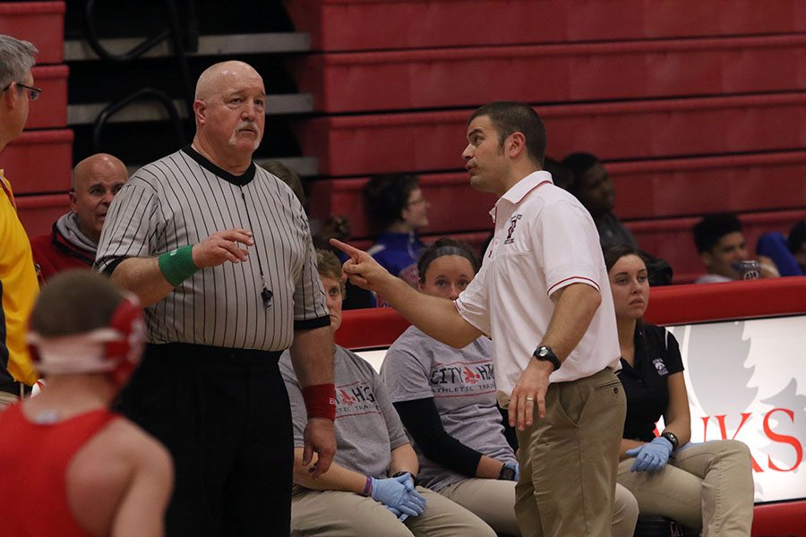 Coach Corey Connel argues with an official during the meet against Kennedy.