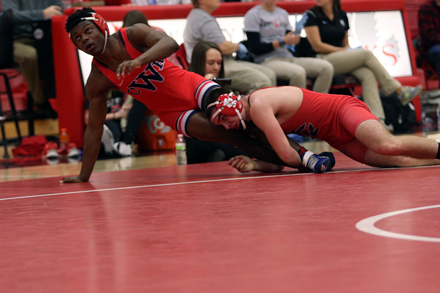 Kyle Hefley '19 tries to drag his opponent back in bounds during his match.